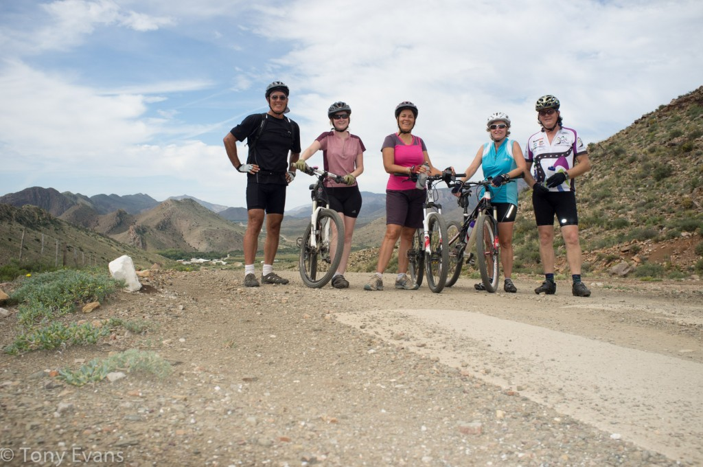 Tony, Chelsea, Carolyn, Irene, Rob with the road ridden in the background.